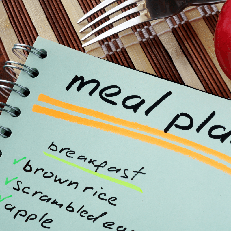 Meal Planner notebook with fork and an apples